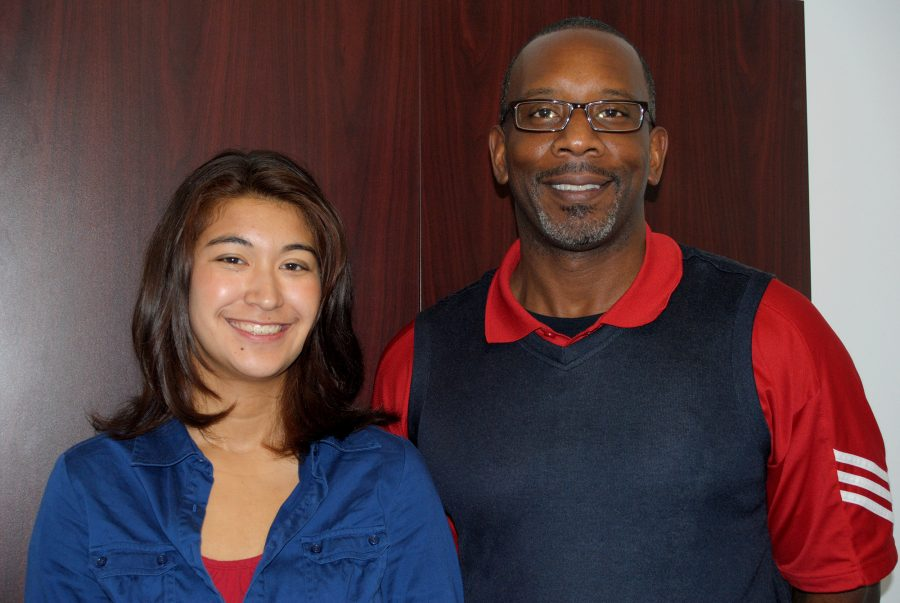Natalie Burlew (19), semifinalist in the National Merit Scholarship competition, stands by Principal Gregory Daniel.