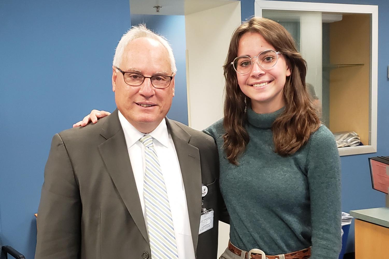 Superintendent Scott Kizner poses with reporter Aynsleigh Escher ('20).