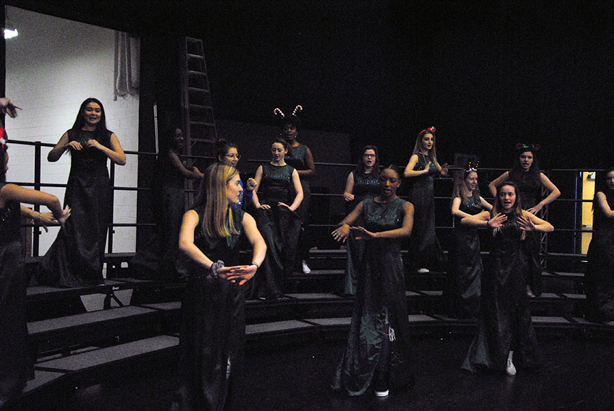 Chamber+Chorus+performs+their+choreography+to+%22Cool+Yule%22+in+their+dresses.