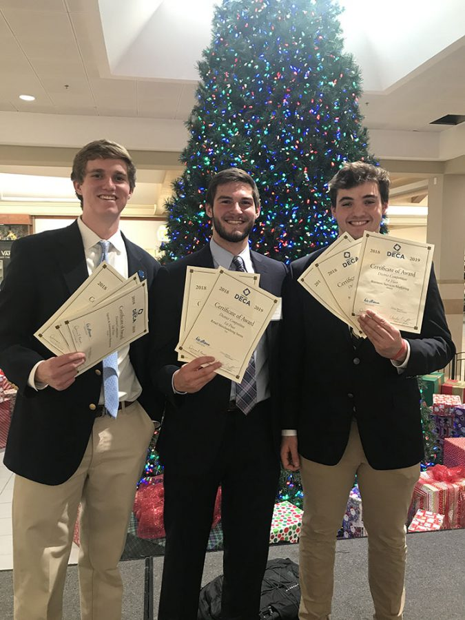 David Weekman ('19) with Steven Dean ('19) and Matthew Hickey ('19) at a district level DECA competition.