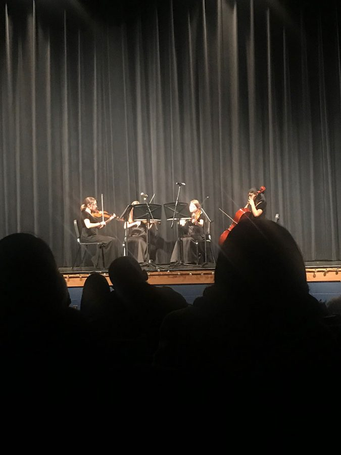 Prior to the winter orchestra concert (20') Camila Reyes Rios, (21') Jaime Erfurdt , (21') Jenna Erfrudt , and (21') Nithya Gottipati play. They were performing
