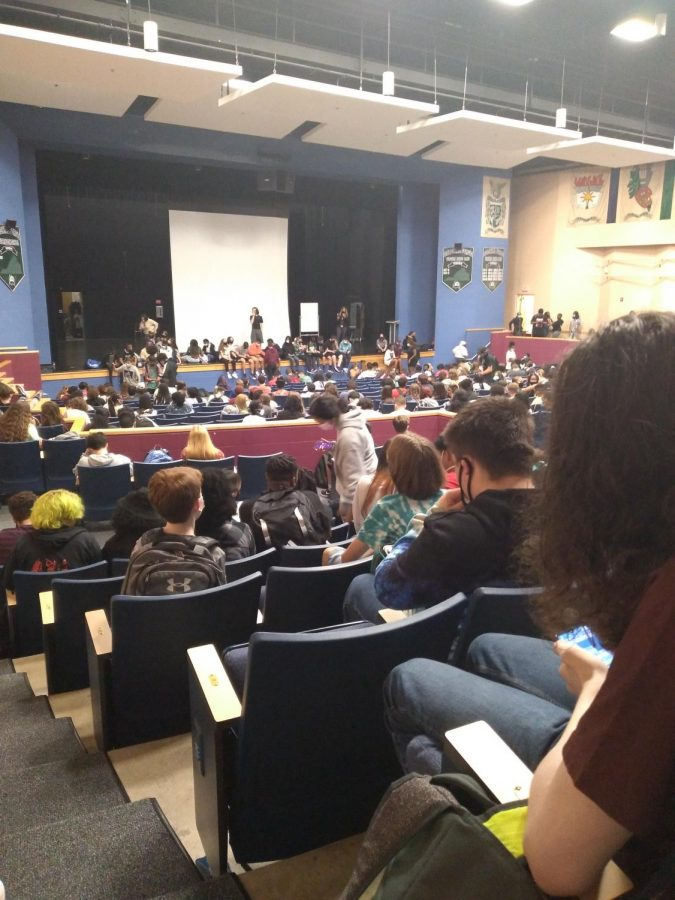 Students waiting in the auditorium for late buses. Photo: Jordan Mellender