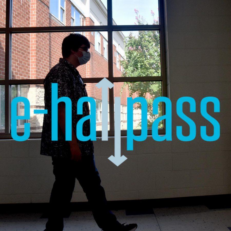 Steven Blackledge (24) walks down the halls after activating an e-hallpass.
