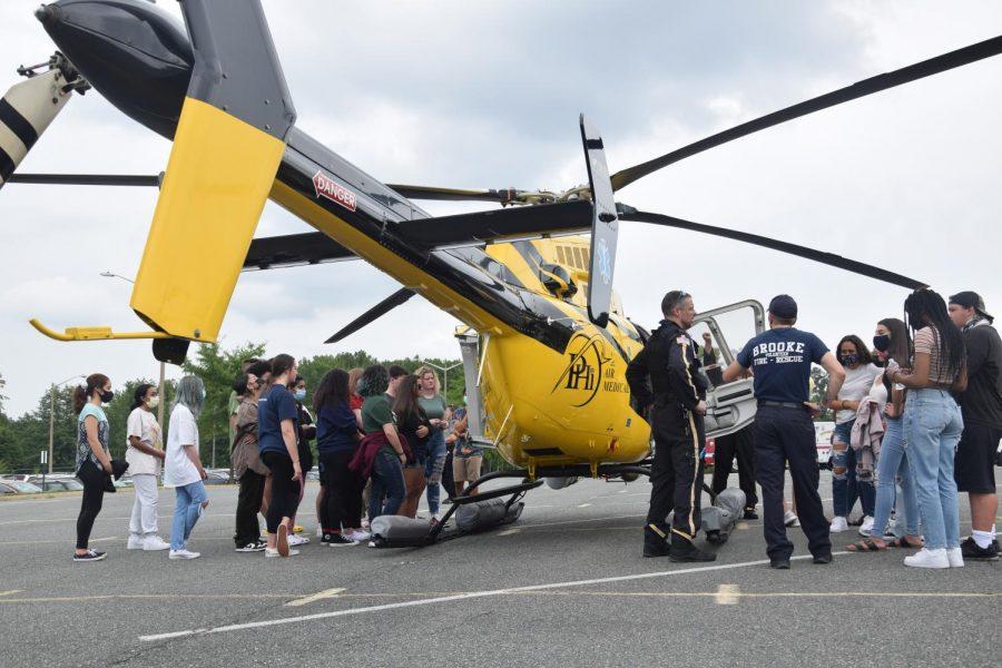 PHI Air Medial helicopter lands in the bus loop